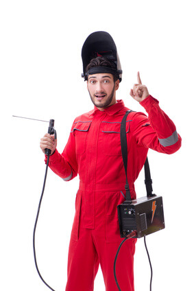 Young repairman with a welding gun electrode and a helmet isolat