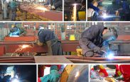 Welders working in factory