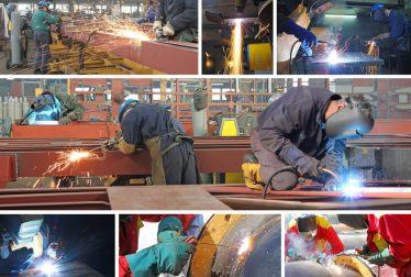Welders working in factory