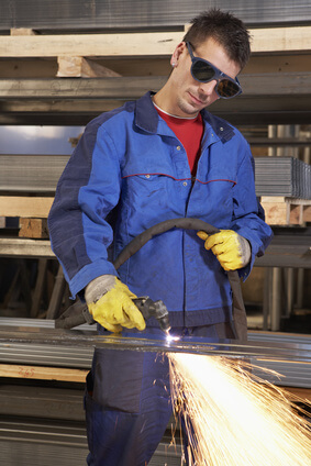 How Does a Plasma Cutter Work-man working with plasma cutter